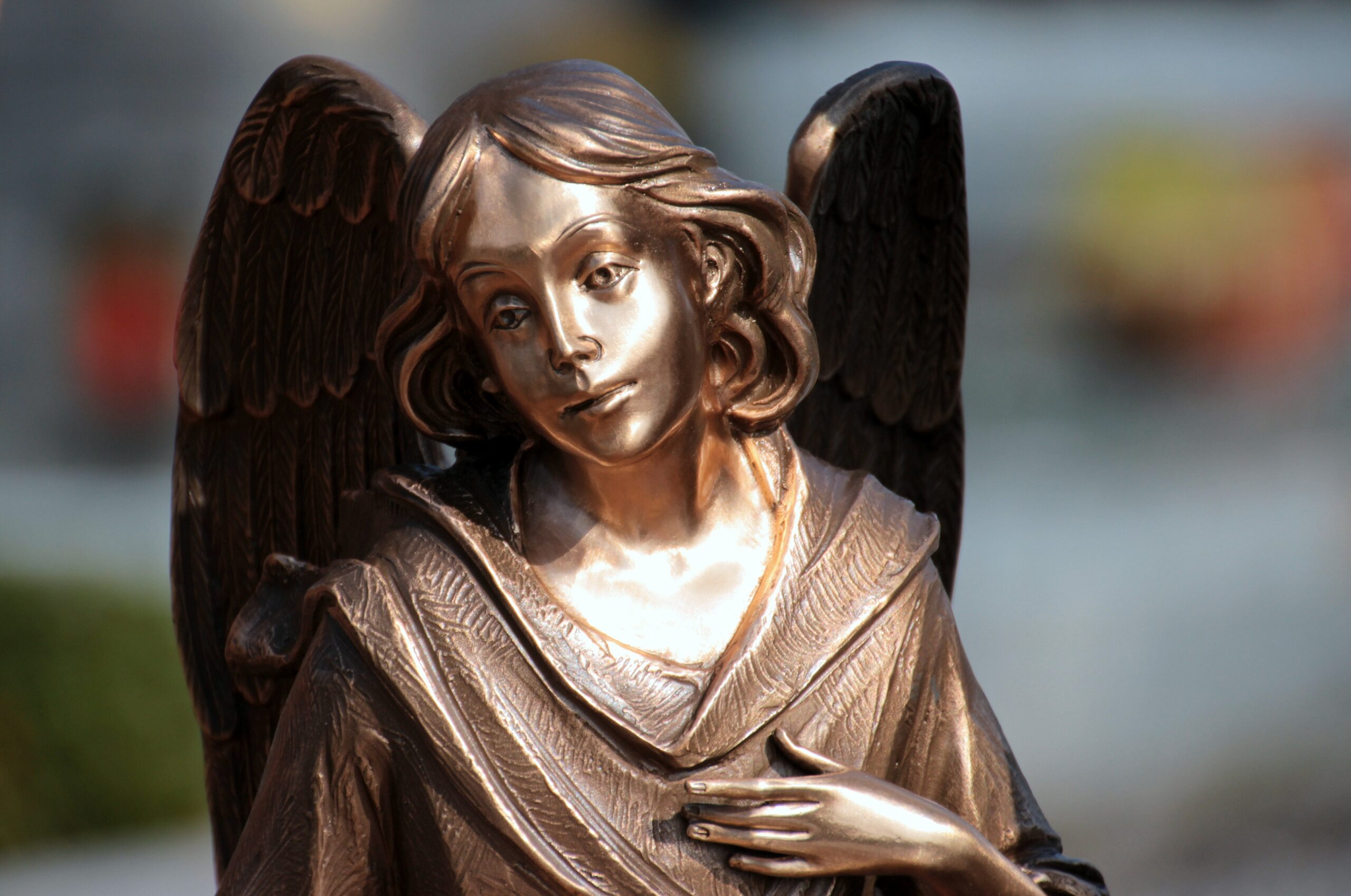 https://get.pxhere.com/photo/sweet-monument-statue-symbol-sculpture-angel-art-temple-tomb-angel-figure-mourning-consolation-bronze-statue-angel-wings-angel-face-fictional-character-816147.jpg